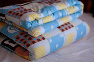 В чем преимущества шерстяного детского одеяла